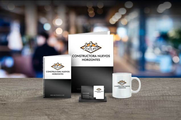 Diseño de logotipo presentado en productos promocionales.